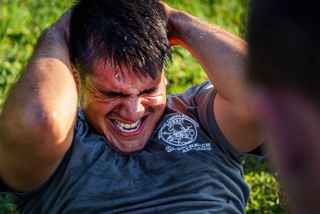 Air Force Tech. Sgt. David Alderete participates in the situps event during the Fourth Annual Spc. Hilda I. Clayton Best Combat Camera Competition at Fort Meade, Md., July 11, 2016. Alderete is assigned to the 1st Combat Camera Squadron. Air Force photo by Airman 1st Class Kyle Hagan