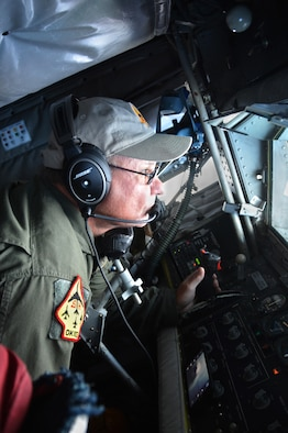 JOINT BASE PEARL HARBOR-HICKAM (July 11, 2016) Master Sgt. Steven Switzer, a KC-135R in-flight refueling technician with the 465th Air Refueling Squadron at Tinker Air Force Base, Okla., operates the boom July 11, 2016 over the Pacific Ocean in support of Rim of the Pacific exercise 2016. RIMPAC is the world's largest international maritime exercise which provides a unique training opportunity that helps participants foster and sustain the cooperative relationships that are critical to ensuring the safety of sea lanes and security on the world's oceans. (U.S. Air Force photo/Master Sgt. Grady Epperly)