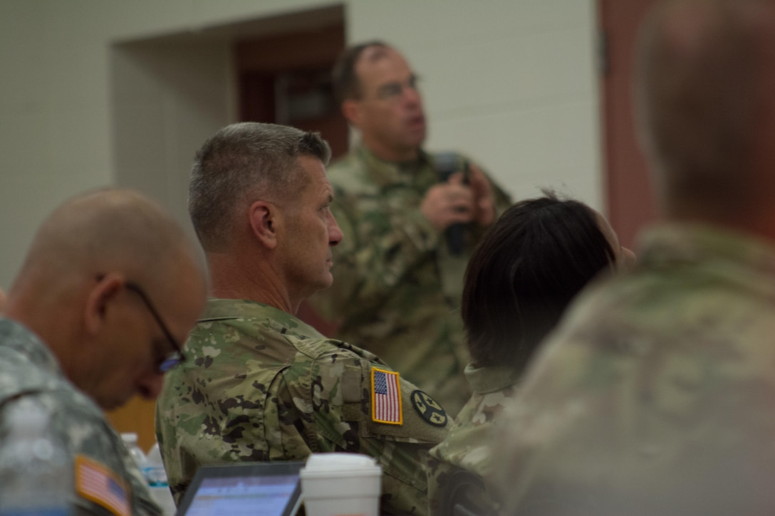 Maj. Gen. Jeffrey Holmes, deputy adjutant general for the Tennessee National Guard, listens on as speakers present their briefings during the Engineer Total Planning Exercise (ENTAPE). ENTAPE is an exercise that brings together the senior engineer leadership from all components of the Army, in order to network, plan, and coordinate future capabilities. (U.S. Army photo by Staff Sgt. Jason Proseus/Released)