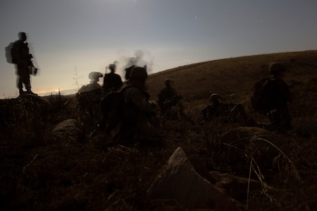 "Marines with 5th Marine Regiment, 1st Marine Division move towards defensive positions during the 1st Marine Division Infantry Squad Competition July 14, 2016 at Camp Pendleton, California. The 1st Marine Division hosted their annual Infantry Squad or ""Super Squad"" competition which pits the 1st, 5th and 7th Marine Regiments and a Light Armored Reconnaissance Battalion against each other in tests designed to evaluate their leadership and small unit infantry skills. (U.S. Marine Corps photo by Sgt. Abbey Perria)"