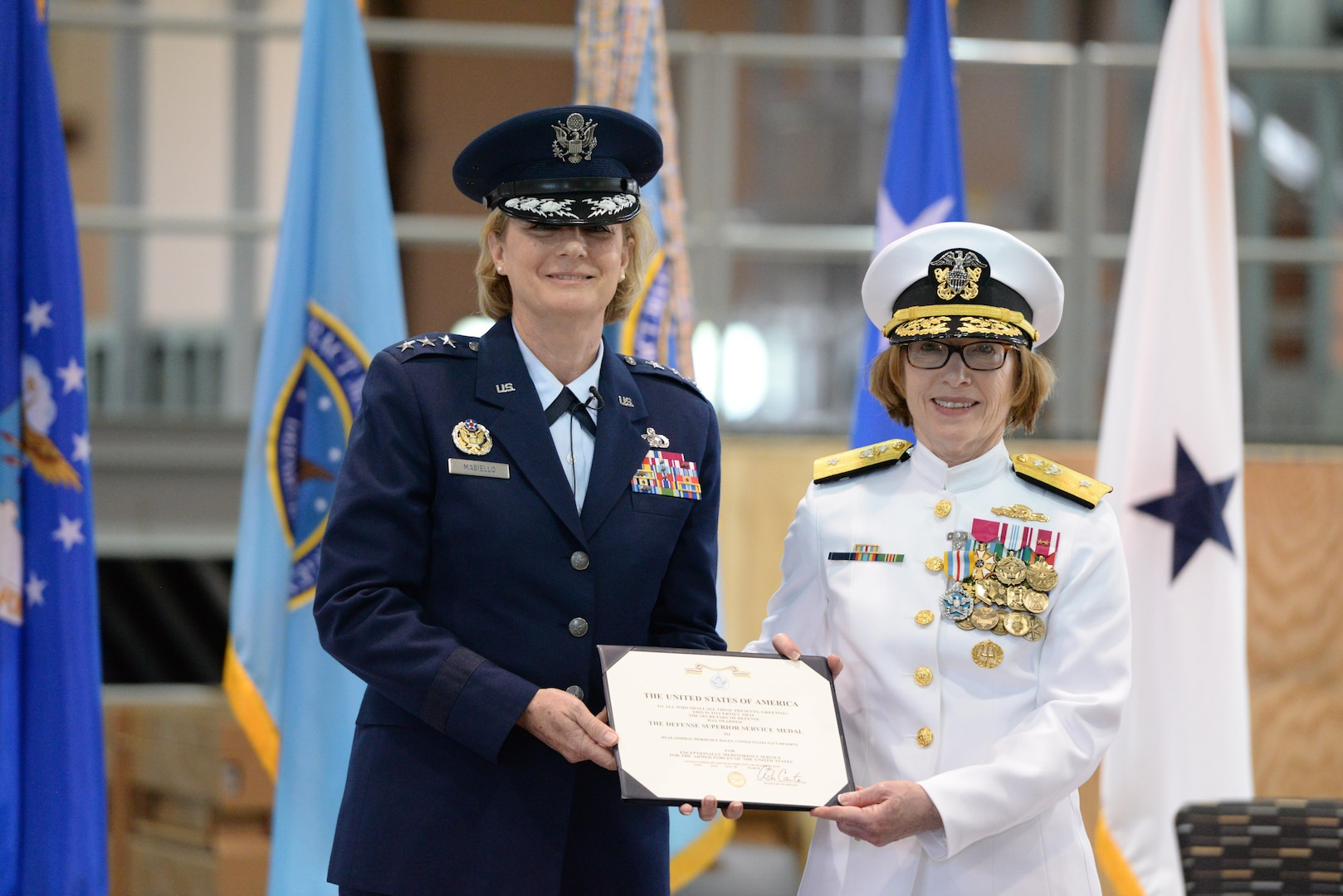 Defense Contract Management Agency director, Air Force Lt. Gen. Wendy Masiello, awards the Navy Defense Superior Service Medal to Navy Rear Adm. Deborah Haven for her three years of service as the DCMA International commander during a change of command ceremony at Fort Lee, Virginia, May 23. Haven will continue her service with the agency as the chief of staff.