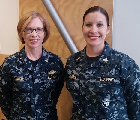 Navy Rear Adm. Deborah Haven, Defense Contract Management Agency International commander, and Navy Lt. j.g. Amy Aguirre (pictured as an Ensign), at Operational Contract Support Joint Exercise 2015 in Fort Bliss, Texas. Aguirre, a Navy reservist assigned to DCMA for the exercise, was in the Contingency Contract Administration Services cell at OCSJX-15.