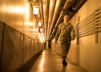U.S. Air Force Airman 1st Class Troy Moncrief, a 354th Civil Engineering Squadron wastewater apprentice, walks down the hall of the Eielson Air Force Base, Alaska, wastewater treatment plant July 14, 2016. Moncrief compares the underground portion of the plant to a submarine with its low hanging pipes, ladders, and tight spaces. (U.S. Air Force photo by Staff Sgt. Shawn Nickel)