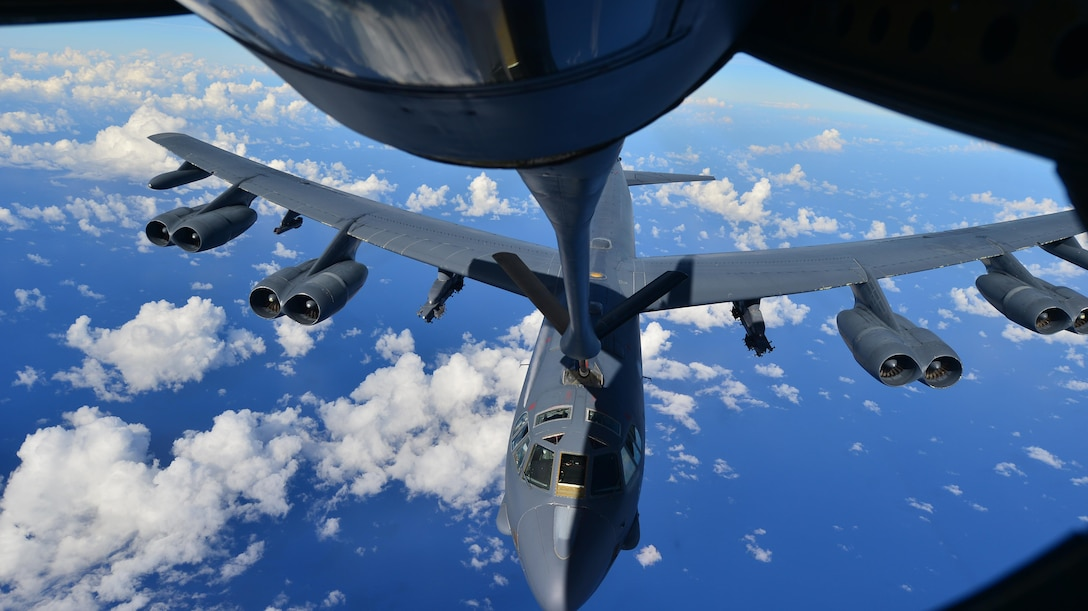 A B-52H Stratofortress assigned to the 69th Bomb Squadron, Minot Air Force Base, N.D., prepares to receive fuel from a KC-135 Stratotanker over the Pacific Ocean during an international sinking exercise for Rim of the Pacific 2016 near Joint Base Pearl Harbor-Hickam, July 14, 2016. Twenty-six nations, more than 40 ships and submarines, more than 200 aircraft, and 25,000 personnel are participating in RIMPAC from June 30 to Aug. 4 in and around the Hawaiian Islands and Southern California. The world's largest international maritime exercise, RIMPAC, provides a unique training opportunity that helps participants foster and sustain the cooperative relationships that are critical to ensuring the safety of sea lanes and security on the world's oceans. RIMPAC 2016 is the 25th exercise in the series that began in 1971. (U.S. Air Force photo by Tech. Sgt. Aaron Oelrich/Released)