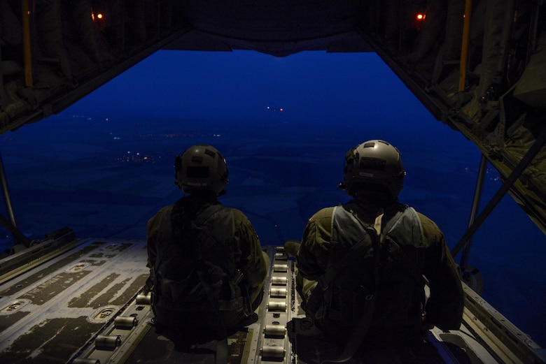 Senior Airman Emily Mitchell and Staff Sgt. Joshua Nelson, both 37th Airlift Squadron loadmasters sit on the ramp of a C-130J Super Hercules during a formation flight during Exercise Thracian Summer 2016 July 17, Plovdiv, Bulgaria. Through Exercise Thracian Summer, the U.S. and Bulgaria will enhance their mutual ability to work together, with other NATO nations, and with key partners on regional security (U.S. Air Force photo/Senior Airman Nicole Keim)