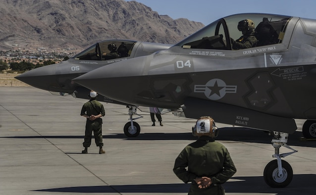 Marine F-35B aircrew members, assigned to the 3rd Marine Aircraft Wing, Marine Corps Air Station Yuma, Az., perform pre-flight checks and participate in Red Flag 16-3 at Nellis Air Force Base, Nev., July 12, 2016. Since its establishment in 1975, Red Flag has played host to military units from more than 30 countries to participate in high-end flight integration. (U.S. Air Force photo by Airman 1st Class Kevin Tanenbaum)