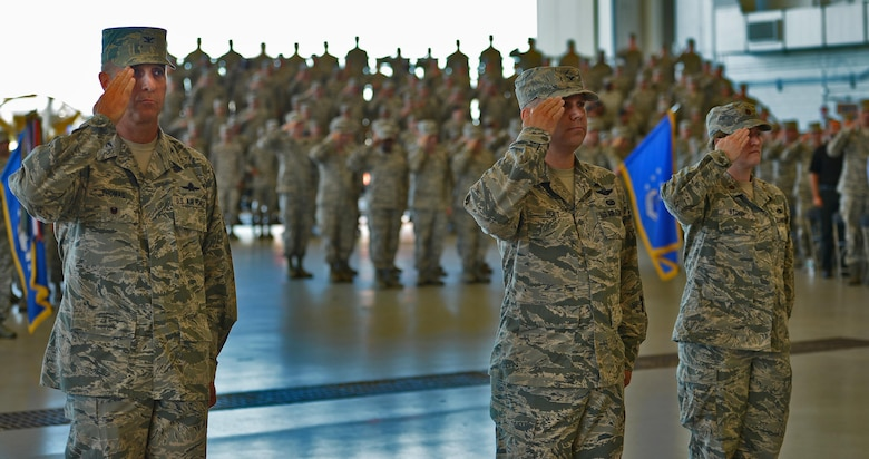 Col. Anthony Thomas, Air Force Special Operations Command director of cyber and command, control, communications and computer systems; Col. William Holt, AFSOC director of operations; and Maj. Lisa Stokey, executive officer to the AFSOC vice commander, lead the formation of Air Commandos at the change of command ceremony, July 19, 2016, held in Freedom Hangar.  (U.S. Air Force photo by Staff Sgt. Melanie Holochwost)