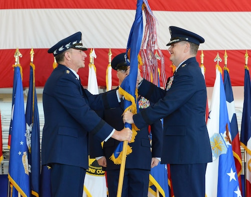 Gen. David L. Goldfein, Chief of Staff of the U.S. Air Force, presents the Air Force Special Operations Command flag to Lt. Gen. Brad Webb during the change of command ceremony at Hurlburt Field Fla., July 19, 2016.  Webb is the 11th commander of AFSOC, and he returns to the Florida panhandle for his fifth tour of duty.  (U.S. Air Force photo by Staff Sgt. Melanie Holochwost)
