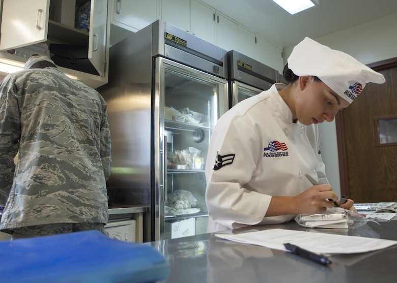 Airman 1st Class Alexandra Ayub, 90th Force Support Squadron missile chef, F.E. Warren Air Force Base, Wyo., takes account of the inventory in her kitchen in the 90th Missile Wing Missile Complex May 14, 2016. Ayub recently won the Arthur J. Myers Food Service Excellence Award, an Air Force-level award for contributing significantly to the food services career field. (U.S. Air Force photo by Lan Kim)
