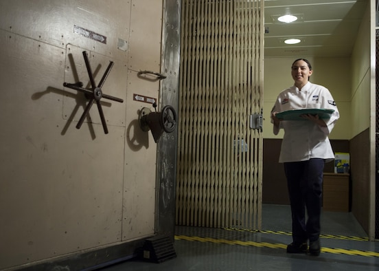 Airman 1st Class Alexandra Ayub, 90th Force Support Squadron missile chef, F.E. Warren Air Force Base, Wyo., exits the elevator leading to the underground launch control center at a missile alert facility in the 90th Missile Wing Missile Complex May 17, 2016. Missile chefs are the chiefs of morale at each MAF, and a large part of their efforts to that end are fueled by providing Airmen on site nutritious, tasty meals. (U.S. Air Force photo by Lan Kim)