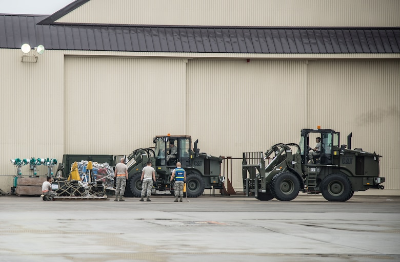 U.S. Air Force Airmen from the 35th Logistics Readiness Squadron load pallets onto a k-loader at Misawa Air Base, Japan, July 17, 2016. The Airmen loaded more than 461,000 pounds of cargo for Exercise Pitch Black, a three-week multi-national exercise including participants from Australia, Canada, France (New Caledonia), Germany, Indonesia, the Netherlands, New Zealand, Singapore, Thailand, Turkey and the United States. (U.S. Air Force photo by Senior Airman Brittany A. Chase)