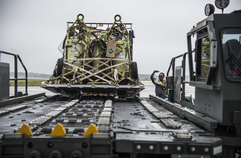 A loadcrew member directs an Airman operating a k-loader at Misawa Air Base, Japan, July 17, 2016. Airmen from the 35th Logistics Readiness Squadron loaded more than 461,000 pounds of cargo destined for Exercise Pitch Black in Australia. Exercise Pitch Black enhances the partnerships of the participing nations and places high value on regional security and fostering closer ties throughout the Indo-Asia-Pacific region. (U.S. Air Force photo by Senior Airman Brittany A. Chase)