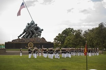 The United States Marine Corps Silent Drill Platoon performs during the Sunset Parade at Arlington, Va., July 19, 2016. The guest of honor for the parade was retired Lt. Col. Jack Matthews and the hosting official was Maj. Gen. John R. Ewers Jr., staff judge advocate to the Commandant of the Marine Corps. (Official Marine Corps photo by Cpl. Chi Nguyen/Released)