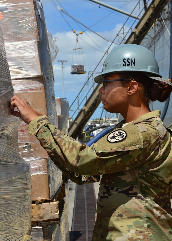 Army Sgt. Lee Jeanpierre, Public Heath Command District Central Pacific Hawaii lead food inspector, inspects a pallet of food prior to delivery to the USS John C. Stennis (CVN-74) on Joint Base Pearl Harbor-Hickam, July 15 2016. Airman from the 15th Aerospace Medicine Squadron are working alongside Soldiers from the Public Heath Command District Central Pacific Hawaii to ensure food is safely delivered to service members aboard 33 military vessels during the 2016 Rim of the Pacific Exercise. Twenty-six nations, more than 40 ships and submarines, 200 aircraft, and 25,000 personnel are participating in RIMPAC from June 30 to Aug. 4, in and around the Hawaiian Islands and Southern California. The world's largest international maritime exercise, RIMPAC provides a unique training opportunity that helps participants foster and sustain the cooperative relationships that are critical to ensuring the safety of sea lanes and security on the world's oceans. (U.S. Air Force photo by Tech. Sgt. Aaron Oelrich/Released)