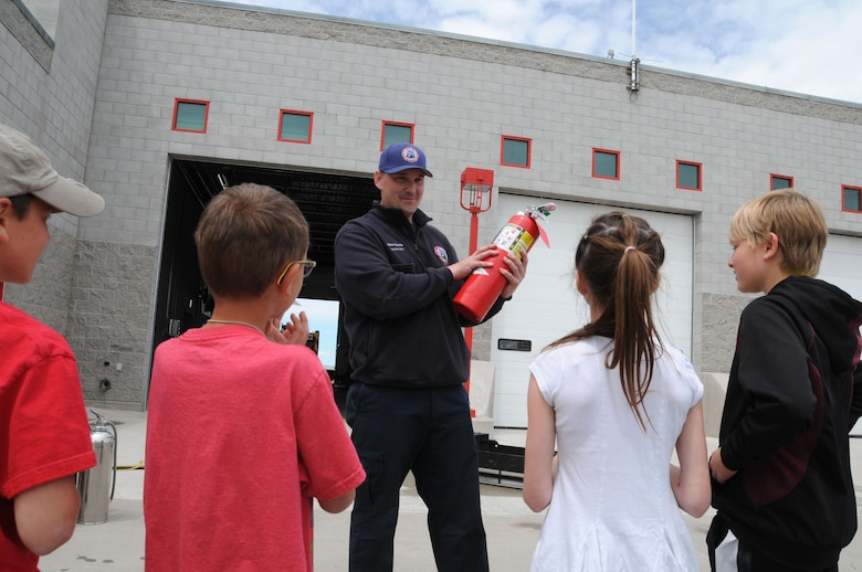 Montana Air National Guard Fire Department Lt. Jacob Harris demonstrates how to operate a fire extinguisher during a STARBASE tour of the station June 15, 2016. (U.S. Air National Guard photo/Senior Master Sgt. Eric Peterson)