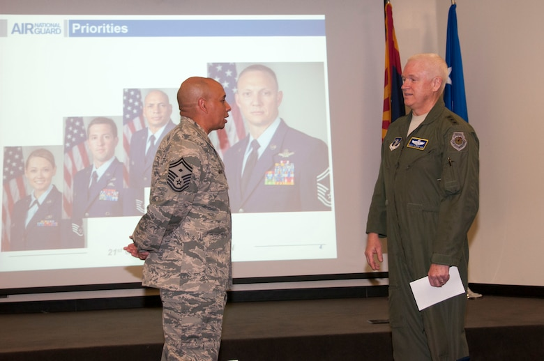 Lt. Gen. L. Scott Rice, director of the Air National Guard, recognized Senior Master Sgt. Jack Minaya, a first sergeant with the 162nd Wing's 214th Reconnaissance Group and one of the 2016 outstanding Airmen during a visit to the Arizona Air National Guard base at Tucson International Airport, June 29-30.  The visit is Rice's first since becoming director. (U.S. Air National Guard photo by 1st Lt. Lacey Roberts)