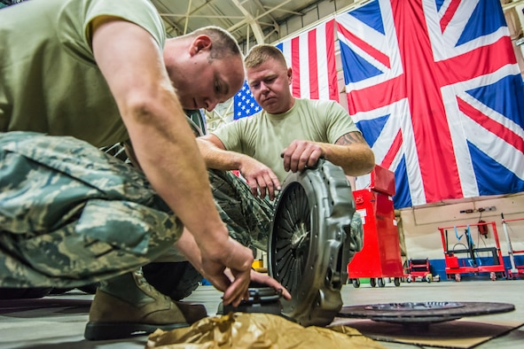 U.S. Air Force Tech Sgt. Brandon M. Guardado (left) and Staff Sgt. Cory C. Clary, with the 139th Logistics Readiness (139 LRS) Squadron replaces a clutch to a MAN 6x4 10-ton tractor at Royal Air Force Mildenhall, England, July 6, 2016.  The 139 LRS were conducting deployment field training in their respective career fields as part of annual training requirements.  (U.S Air National Guard photo by Senior Airman Patrick P. Evenson/Released)