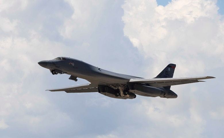 A B-1 bomber soars through the sky during suppression of enemy air defenses training at Ellsworth Air Force Base, S.D., July 15, 2016. During SEAD missions, bombers are used offensively to destroy targets while EA-18G Growlers work as a supporting aircraft to deny, degrade or delay the enemies' ability to acquire and engage friendly air forces and also give bombers access to those targeted areas. (U.S. Air Force photo by Airman 1st Class Sadie Colbert/Released)