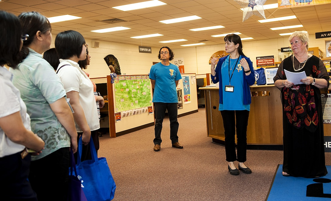 """18th Force Support Squadron librarians gives a tour of the library to local Okinawan librarians July 13, 2016, at Kadena Air Base, Japan. Some Okinawan libraries are setting up an """"American corner"""" in their libraries, where their American customers can come in and learn in a culturally familiar environment. (U.S. Air Force photo by Airman 1st Class Corey M. Pettis)"""