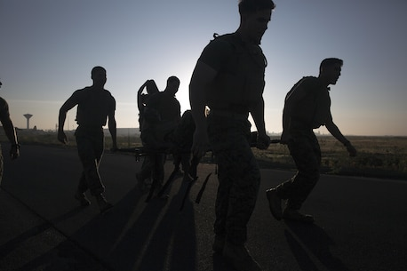 Marines in Corporals Course carry a litter during a casualty evacuation physical training event in the morning at Naval Air Station Sigonella, Italy, June 11, 2016.  Twenty-five Marines with Special Purpose Marine Air-Ground Task Force Crisis Response-Africa learned leadership skills, land navigation, sword and guidon manual, fire team and squad formations, and mentoring skills during the course. (U.S. Marine Corps photo by Cpl. Alexander Mitchell/released)