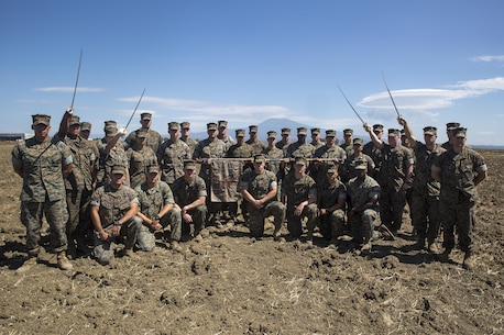 Marines in Corporals Course stand with their instructors for a group photo at Naval Air Station Sigonella, Italy, June 14, 2016.  Twenty-five Marines with Special Purpose Marine Air-Ground Task Force Crisis Response-Africa learned leadership skills, land navigation, sword and guidon manual, fire team and squad formations, and mentoring skills during the course.  (U.S. Marine Corps photo by Cpl. Alexander Mitchell/released)
