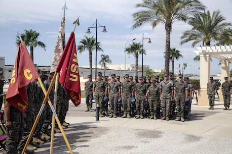 Marines in Corporals Course stand at attention with their instructors during a graduation ceremony at Naval Air Station Sigonella, Italy, June 22, 2016.  Twenty-five Marines with Special Purpose Marine Air-Ground Task Force Crisis Response-Africa learned leadership skills, land navigation, sword and guidon manual, fire team and squad formations, and mentoring skills during the course.  (U.S. Marine Corps photo by Cpl. Alexander Mitchell/released)