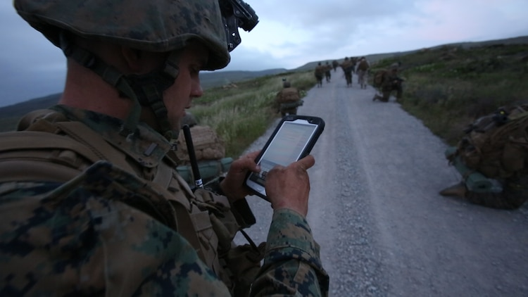 The MAGTF Common Handheld program will allow Marines to securely use modern handheld communications devices like tablets and smartphones in tactical environments to make more informed decisions on the go. Marine Corps Systems Command partnered with the National Security Agency's Commercial Solutions for Classified program to address the unique security considerations inherent in using commercial products for tactical purposes. (U.S. Marine Corps photo by Pfc. Tyler W. Stewart)