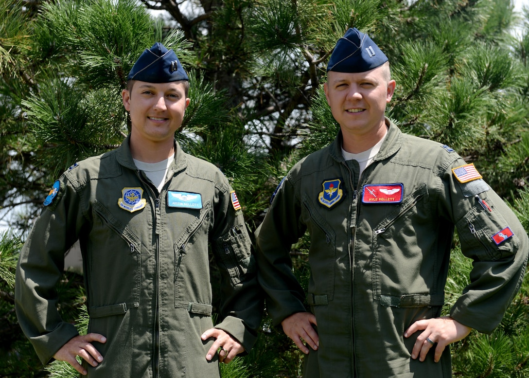 U.S. Air Force Capt. Justin Kellett, C-5 Galaxy pilot and U.S. Air Force Capt. Kyle Kellett, C-17 Globemaster III pilot, pose for a photo, July 12, 2016 at Altus Air Force Base. Close in age, the brothers have spend their entire lives in similar paths of life and now find themselves temporarily at Altus Air Force Base together.(U.S. Air Force Photo by Airman Jackson N. Haddon/Released).
