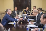 Defense Secretary Ash Carter, left, shakes hands with French Defense Minister Jean-Yves Le Drian at a meeting of defense ministers and senior leaders from the coalition to counter the Islamic State of Iraq and the Levant at Joint Base Andrews, Md., July 20, 2016. DoD photo by Air Force Tech. Sgt. Brigitte N. Brantley