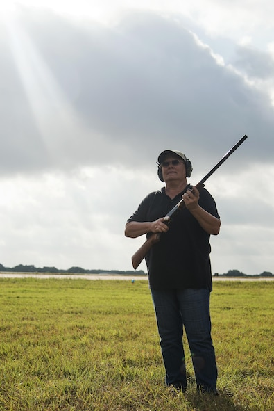 Vivian Prothro, U.S. Department of Agriculture staff wildlife biologist, prepares to fire a 15 mm. Bird Banger near the east flight line July 13, 2016 at Joint Base San Antonio-Randolph. Bird/Wildlife Aircraft Strike Hazard Program team members use bangers, screamers and cracker shells, which are various types of pyrotechnics, to scare birds and wildlife away from where aircraft are taking off and landing.