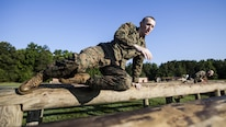 Candidates with India Company, Officer Candidate School, conduct the obstacle course at Marine Corps Base Quantico, Virginia, July 17, 2016. The mission of OCS is to educate and train officer candidates in order to evaluate and screen individuals for qualities required for commissioning as a Marine Corps officer.