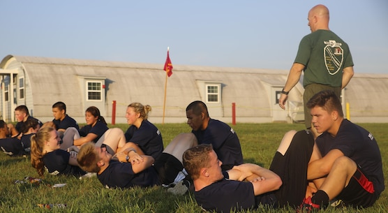 Students from Marine Corps Recruiting Command's Summer Leadership and Character Development Academy conduct crunches as part of their modified physical fitness tests July 20, 2016. SLCDA is part of the Marine Corps' community outreach program, designed to impart Marine Corps ethics, values, and leadership traits to high school Juniors and Seniors.
