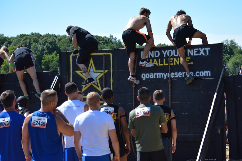 HUGO, Minn. -- Tough Mudder participants surmount the first challenge in the approximately 11-mile, military-style obstacle course held in Hugo, Minnesota July 16-17, 2016. The Army Reserve sponsors the events in an effort to strengthen its partnership with the local community, while fostering the resilience of Soldiers, Families, and Civilians.
