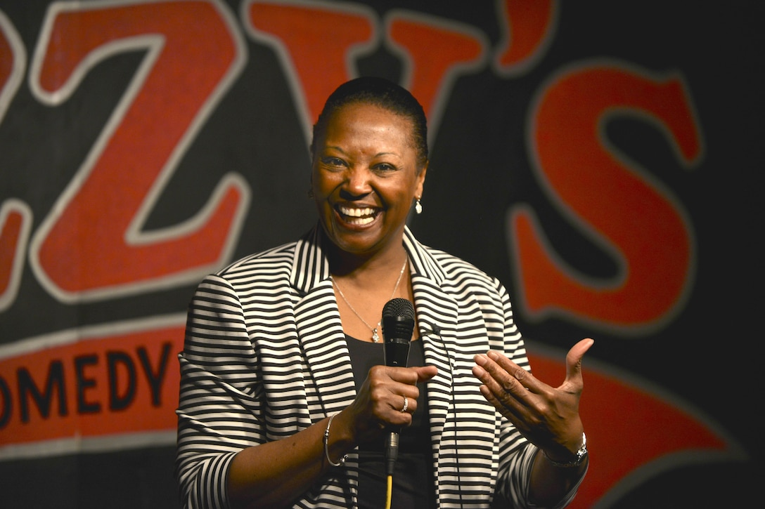 Retired Maj. Darlean Basuedayva, a health promotion officer for the U.S. Army Public Health Center, performs a comedy routine at a club in Newport News, Va., April 14, 2016. Basuedayva's performance was part of the Armed Services Arts Partnership, which provides military service members and veterans the opportunity to learn artistic skills from artists, art organizations and art students. (U.S. Air Force photo/Staff Sgt. Natasha Stannard)
