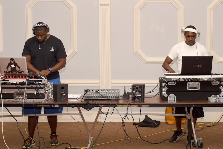 Senior Airman Christopher Allen (left), 4th Maintenance Group integrated avionics technician, and Staff Sgt. Jonathan Gambrell, 4th Equipment Maintenance Squadron supply liaison, practice mixing different beats during the Make it Better DJ and Producers Club meeting July 17, 2016, at Seymour Johnson Air Force Base, North Carolina. Allen and Gambrell have more than six years of turntable mixing experience between them. (U.S. Air Force photo by Airman Miranda Loera)