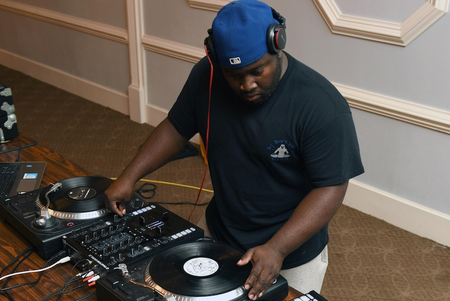 Staff Sgt. Eric Prince, 4th Component Maintenance Squadron aerospace propulsion technician, mixes a track he created during the Make it Better DJ and Producers Club meeting July 17, 2016, at Seymour Johnson Air Force Base, North Carolina. The DJ and Producers club meetings are held every Sunday at 3 p.m., in the Eagles Landing ballroom. (U.S. Air Force photo by Airman Miranda Loera)