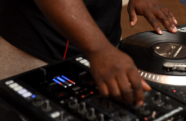 Staff Sgt. Eric Prince, 4th Component Maintenance Squadron aerospace propulsion technician, practices mixing on his turntable during the Make it Better DJ and Producers Club meeting July 17, 2016, at Seymour Johnson Air Force Base, North Carolina. The DJ and Producers Club's goal is to provide a positive and educational atmosphere to those interested in joining the music entertainment world. (U.S. Air Force photo by Airman Miranda Loera)