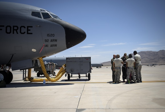 Aircrew and ground personnel conduct a pre-flight check at Nellis Air Force Base, Nevada July 18, 2015 during exercise Red Flag. The aircrew went on to refuel several exercise participants. (U.S. Air Force photo/Tech. Sgt. David Salanitri)