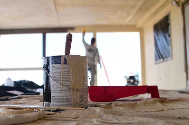 Airmen from the 460th Civil Engineer Squadron renovate a building July 18, 2016, on Buckley Air Force Base, Colo. The building being renovated will be used for Cinderella's Closet, a place where military members and their dependents can buy gently used formal wear for balls and ceremonies. The 460th CES develops, constructs, operates, and sustains the infrastructure on Buckley AFB. (U.S. Air Force photo by Airman 1st Class Luke W. Nowakowski/Released)