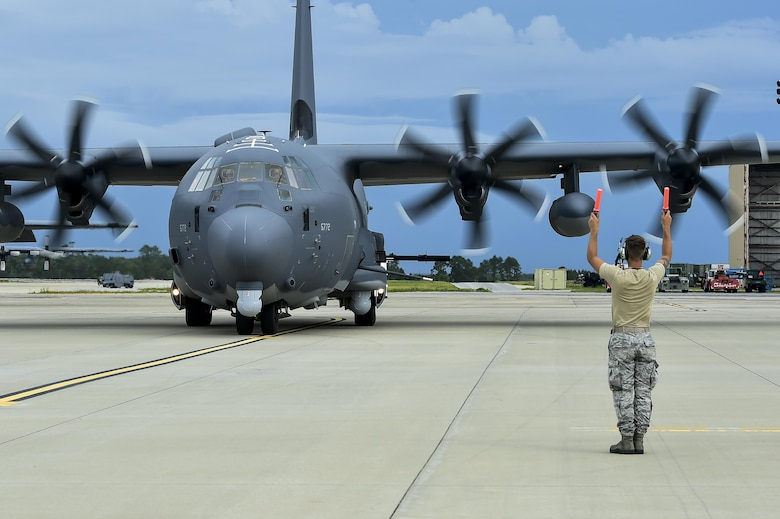 A newly arrived AC-130J Ghostrider gunship, Block 20 model, is marshaled into a parking spot at Hurlburt Field, Fla., July 18, 2016. The AC-130J is the fourth generation gunship replacing the aging fleet of AC-130U/W gunships. Over the past four decades, AC-130s have deployed constantly to hotspots throughout the world in support of special operations and conventional forces. (U.S. Air Force by Senior Airman Jeff Parkinson)