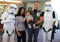 Star Wars Storm Troopers pose for a photo with Sgt. James J. Nieves and his family during Recruiting Station Los Angeles' Family Day at Naval Base Ventura County Port Hueneme, July 16, 2016. During the family day, volunteers from the 501st Legion Southern California Garrison dressed up as Star Wars characters, interacting with families. (U.S. Marine Corps photo by Staff Sgt. Alicia R. Leaders/Released)