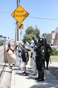 Star Wars characters walk around Naval Base Ventura County, interacting with pedestrians during Recruiting Station Los Angeles' Family Day at Naval Base Ventura County Port Hueneme, July 16, 2016. Volunteers from the 501st Legion Southern California Garrison dressed up as Star Wars characters, interacting with families. (U.S. Marine Corps photo by Staff Sgt. Alicia R. Leaders/Released)