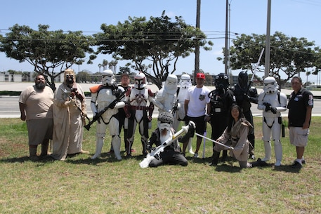 Gunnery Sgt. Jose A. Mireles, supply chief for Recruiting Station Los Angeles, poses for a photo with Star Wars characters during RS Los Angeles' Family Day at Naval Base Ventura County Port Hueneme, July 16, 2016. Volunteers from the 501st Legion Southern California Garrison dressed up as Star Wars characters, interacting with families. (U.S. Marine Corps photo by Staff Sgt. Alicia R. Leaders/Released)