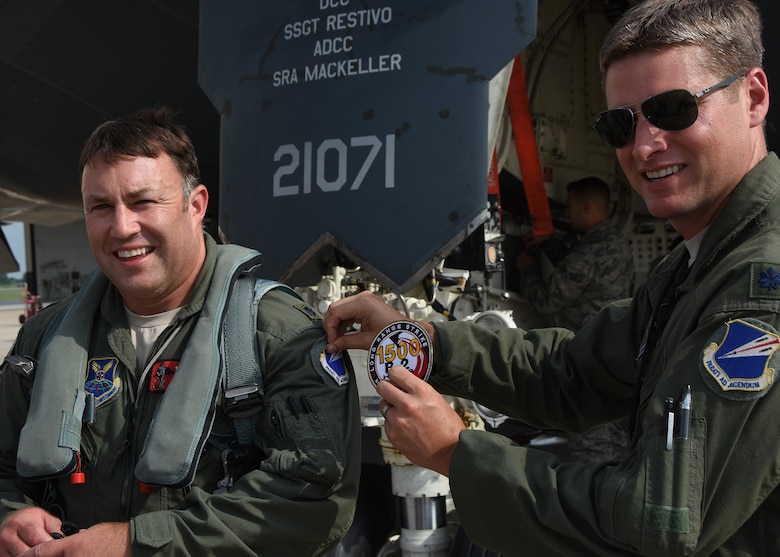 Lt. Col. Jared Kennish, 131st Operations Group commander, Missouri Air National Guard, is presented a 1500-hour patch by Lt. Col. Timothy Rezac, 110th Bomb Squadron commander, at Whiteman Air Force Base, Mo., July 9, 2016.  Kennish joins a small group of B-2 Spirit pilots that have surpassed the 1,000-hour milestone and currently has the most flying hours of any actively flying B-2 pilot.  (U.S. Air National Guard photo by Senior Master Sgt. Mary-Dale Amison)