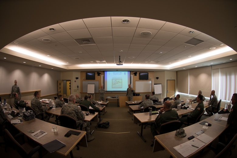 Col. Jeffrey Hedges, 109th Mission Support Group commander, opens up classroom instruction at the Southbridge Conference Center, Southbridge, Massachusetts, on July 12, 2016. Senior officer and enlisted leaders with the 109th Airlift Wing got an historical overview of The American Revolution and had facilitated discussion about strategic planning. (U.S. Air National Guard photo by Senior Airman Jamie Spaulding/Released)