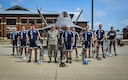 Members of the Air Force Cycling Team pose for a photo in front of the F-22 Raptor at Langley Air Force Base, Va., July 8, 2016. The team will travel to Greenwood, Iowa to ride in the 43rd Register's Annual Great Bicycle Ride Across Iowa, July 21-28. To prepare for the 500-mile ride, the National Capital Region of the AFCT rode approximately 25 to 35 miles three to four times each week. (U.S. Air Force photo by Tech. Sgt. Daylena Ricks)