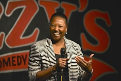 Retired U.S. Air Force Maj. Darlean Basuedayva, U.S. Army Public Health Center and special staff to the Senior Commander Army Element, Center for Initial Military Training health promotion officer, performs a comedy routine at a club in Newport News, Va., April 14, 2016. Basuedayva's performance was a part of the Armed Services Arts Partnership, which provides military service members and veterans the opportunity to learn artistic skills from artists, art organizations and art students. (U.S. Air Force photo by Staff Sgt. Natasha Stannard)