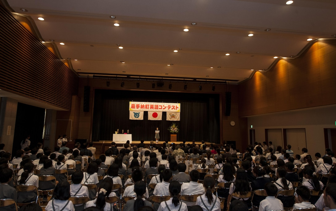 Audience members observe a local Okinawan student's performance during the 19th annual Kadena Language Institute English Contest July 14, 2016, at Kadena Rotary Town Plaza, Okinawa, Japan. Contestants were from Yara Elementary School, Kadena Elementary School and Kadena Junior High School. (U.S. Air Force photo by Airman 1st Class Lynette M. Rolen)