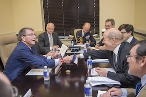 Secretary of Defense Ash Carter meets French Minister of Defense Jean-Yves Le Drian during a meeting of defense ministers of the Global Coalition to Counter ISIL July 20, 2016, at Joint Base Andrews, Md. (DoD photo by Air Force Tech. Sgt. Brigitte N. Brantley/Released)