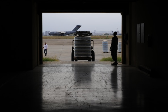 Airmen use a forklift to carry pallets of water into a storage facility July 19, 2016, at Incirlik Air Base, Turkey. A recent loss of commercial power prompted a delivery of fuel, food and water to sustain missions supporting Operation Inherent Resolve. (U.S. Air Force photo by Airman 1st Class Devin M. Rumbaugh)